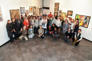 A photograph of over 50 people, students, faculty, and staff, at the opening of the new BHCC Artist in Residency program in the Mary Fifield Art Gallery