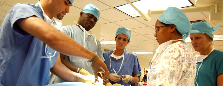 Surgeons and nurses performing an operation
