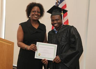student receiving his award