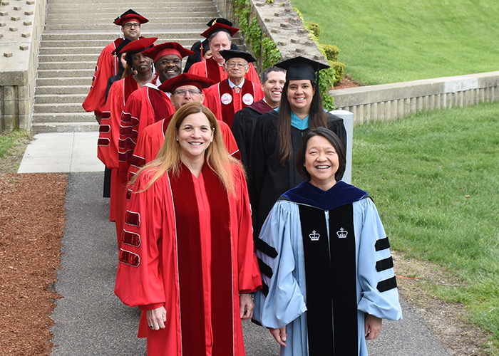 faculty commencement procession lead by President Eddinger and Rosalin Acosta