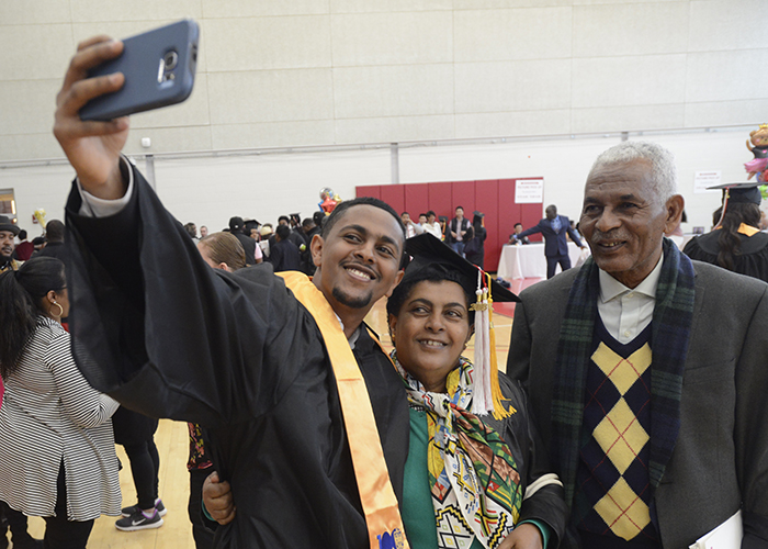 student taking a selfie with his family