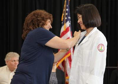 student receiving her medical imaging pin