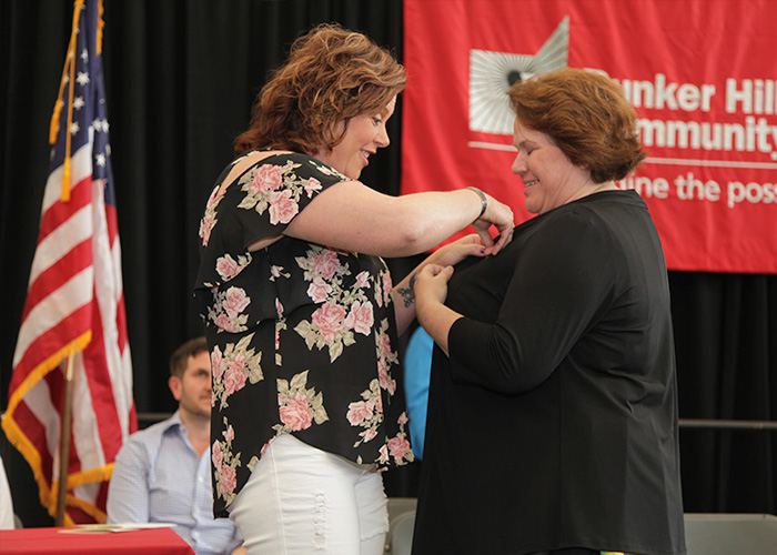 student receiving her nurse pin