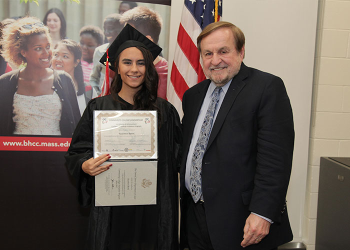 female student posing with certificate and dr. canniff