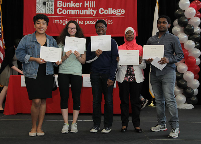 dual enrollment students posing with certificates