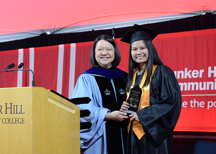 President Eddinger gives female student an award