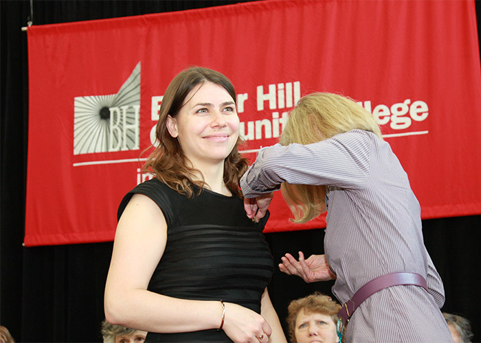 female student receives her nurse pin