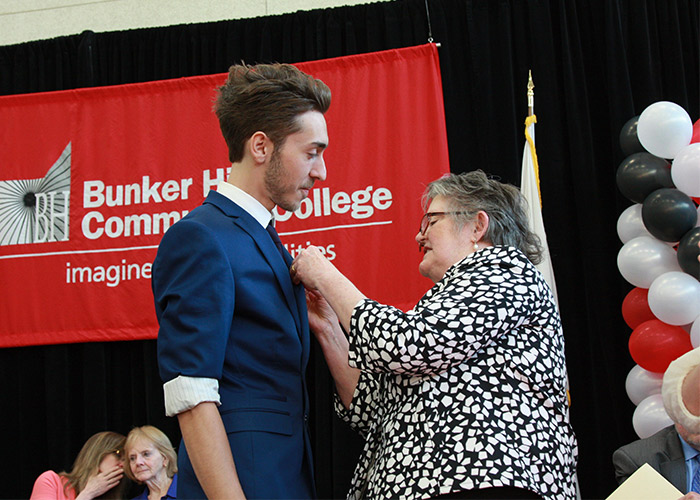 male student receiving his nurse pin