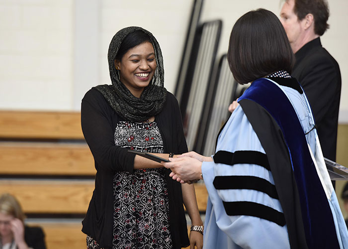 female student receiving an award from President Eddinger