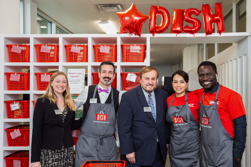 Dr. Caniff posing with DISH staffs