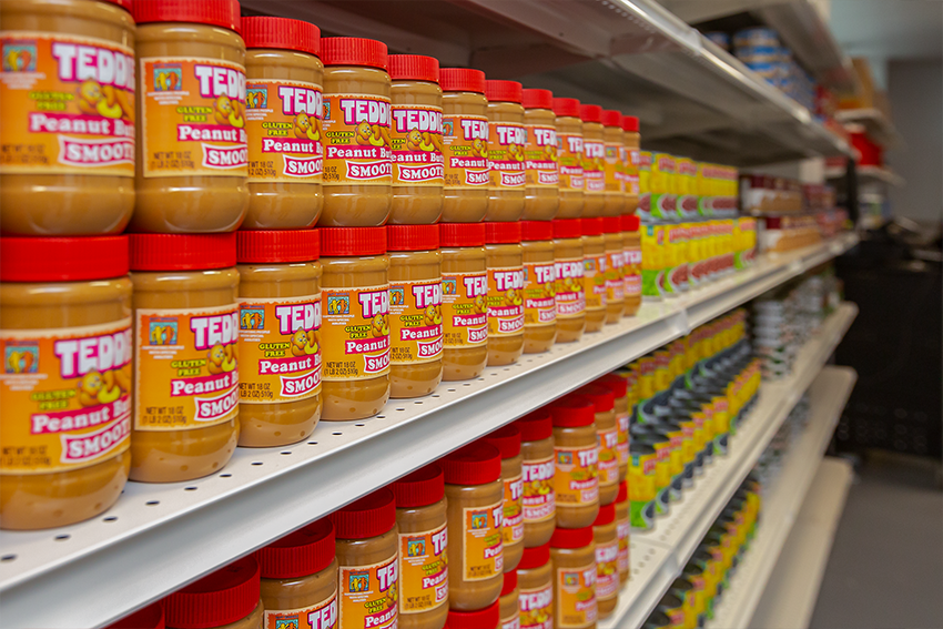 A shelf of peanut butter jars