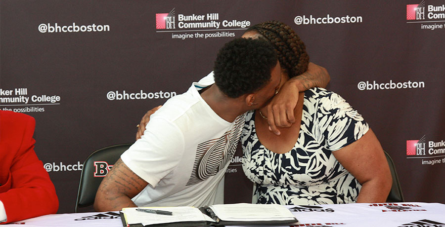 Fredens hugs his mother after signing his letter of intent