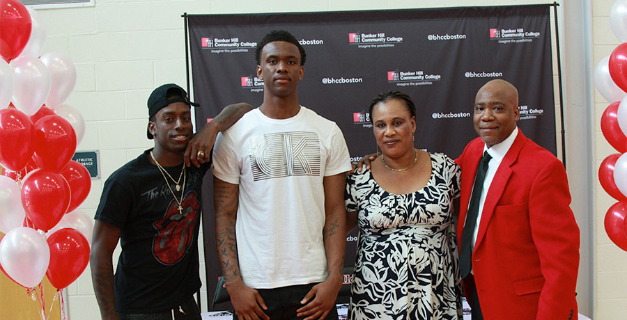 Fredens Deneus with his friend, mother and coach