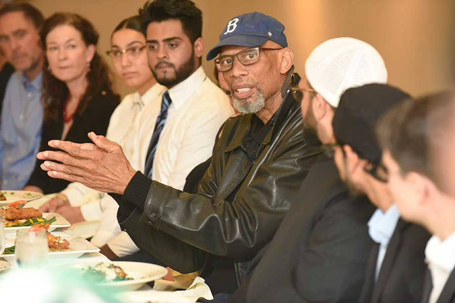 Kareem Abdul-Jabbar talking to faculty and students