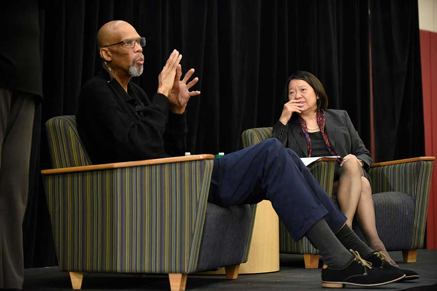 Kareem Abdul-Jabbar talking on stage with BHCC President Pam Eddinger