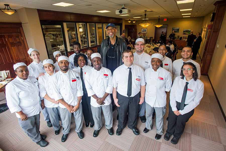 Kareem Abdul-Jabbar at lunch with BHCC Culinary Arts students.