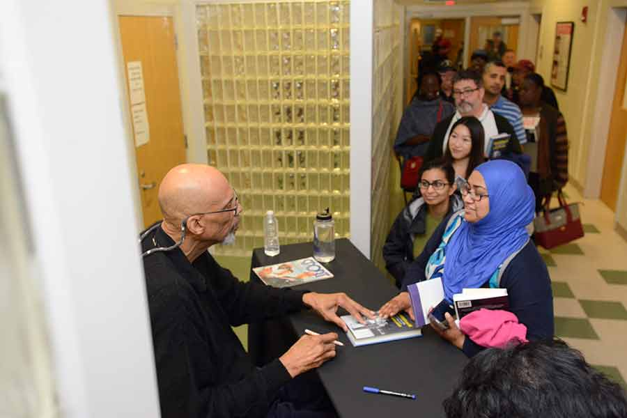 Kareem Abdul-Jabbar signing autographs for BHCC students