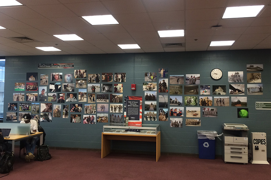 Wall of Honor Veterans Day photo display in the BHCC library