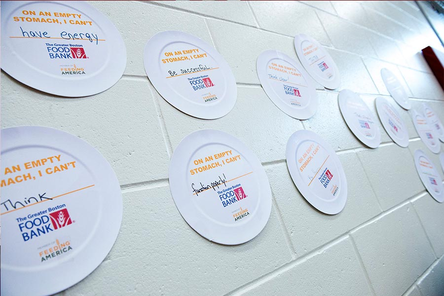 plates on wall displaying student hunger issues