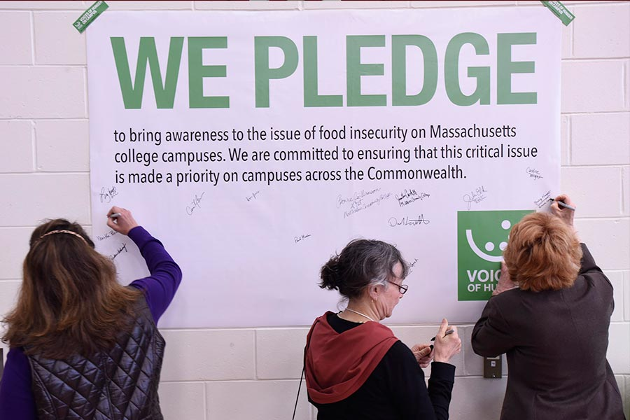 participants signing a pledge poster