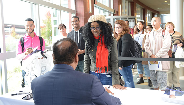 John Quinones meeting and talking with BHCC students during his meet and greet