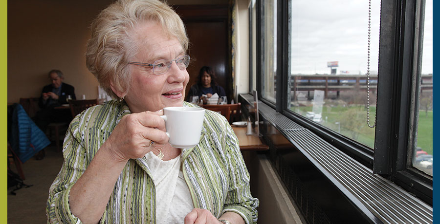 Professor Adele Hamblett enjoying a beverage in the Kershaw Dining Room.