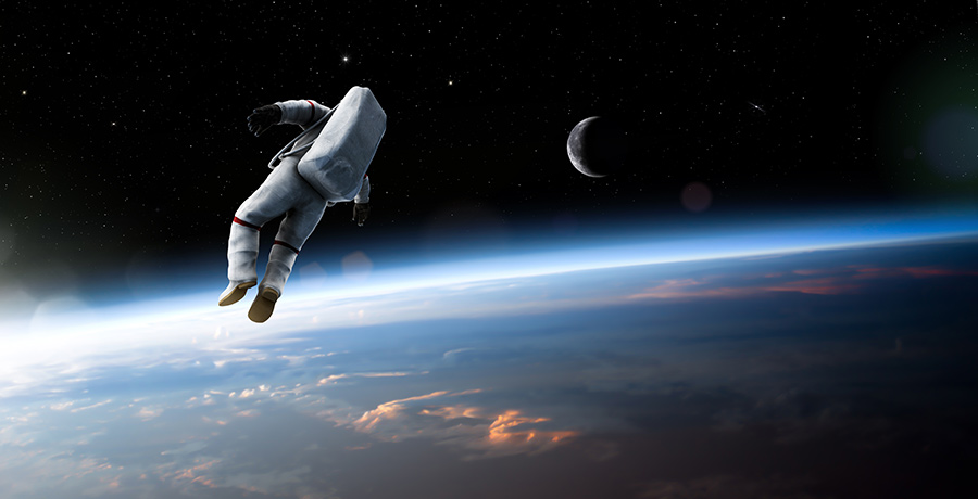Science in Space Begins on Earth Banner - Picture of an astronaut on a space walk above the Earth.