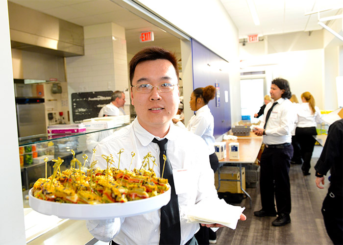 BHCC student serving appetizers