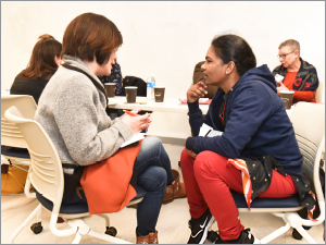BHCC faculty Naoko Akai-Dennis and Bhanumathi Selvara connect in conversation during a workshop session.