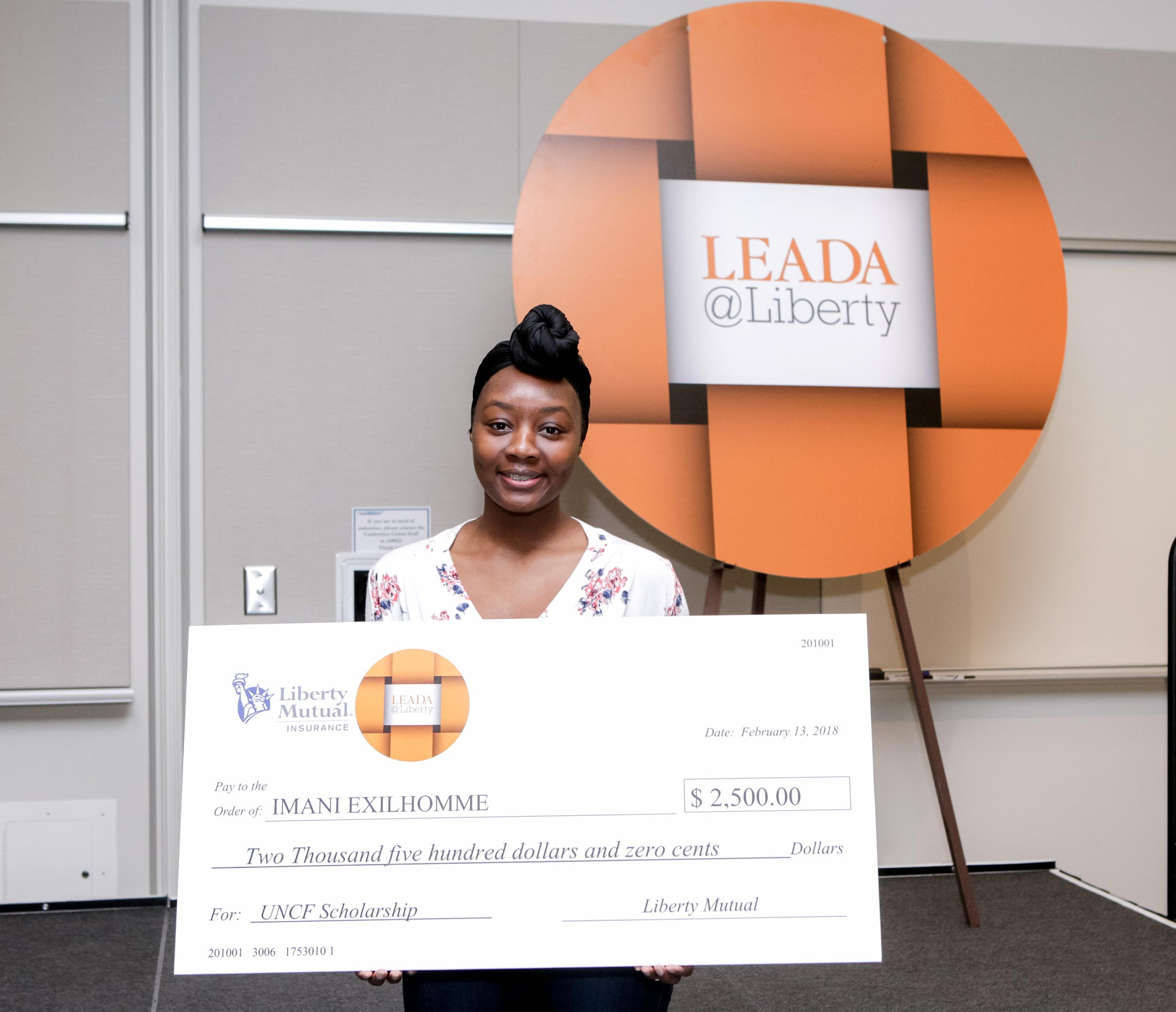 Imani Exilhomme with her liberty mutual scholarship award