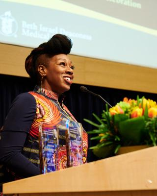 alumna Afi Alfred was honored as a YMCA Achiever for her contributions to her community at the Beth Israel Deaconess Medical Center
