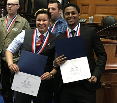 Susan Benitez and Mussie Demisse recieving their Phi Theta Kappa's (PTK) All-Massachusetts Academic Team awards