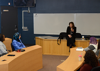 Kathy Najimy speaking to students