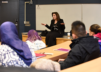 Kathy Najimy speaking with students