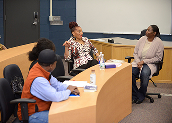 Terry McMillan speaking with BHCC students