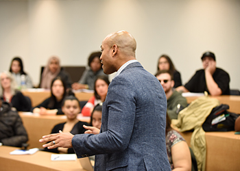 Wes Moore talking to students