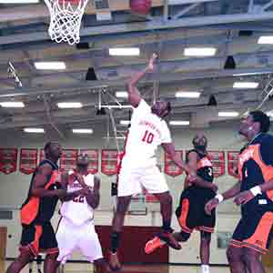 BHCC basketball team driving against opponent