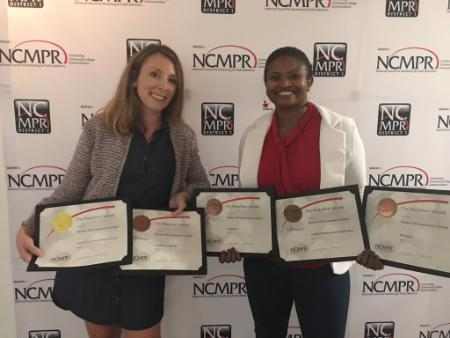 Brooke and Virginia posing with BHCC's 2017 NCMPR awards