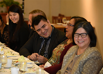 Jose Vargas laughing with guests at the Difficult Dialogues luncheon