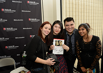 Jose Vargas posing with students during a book signing