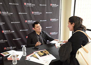 Jose Vargas speaking with a student at his book signing