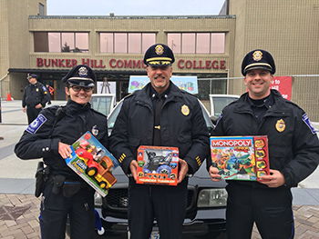 three officers at BHCC Stuff a Cruiser event